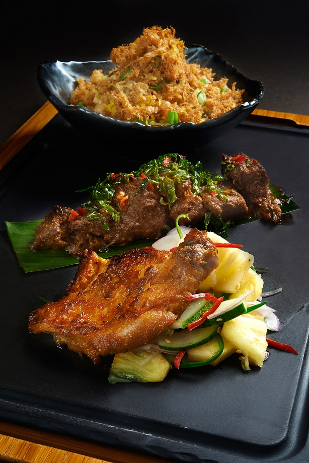 Spice egg rice with local style baked chicken and lamb rendang