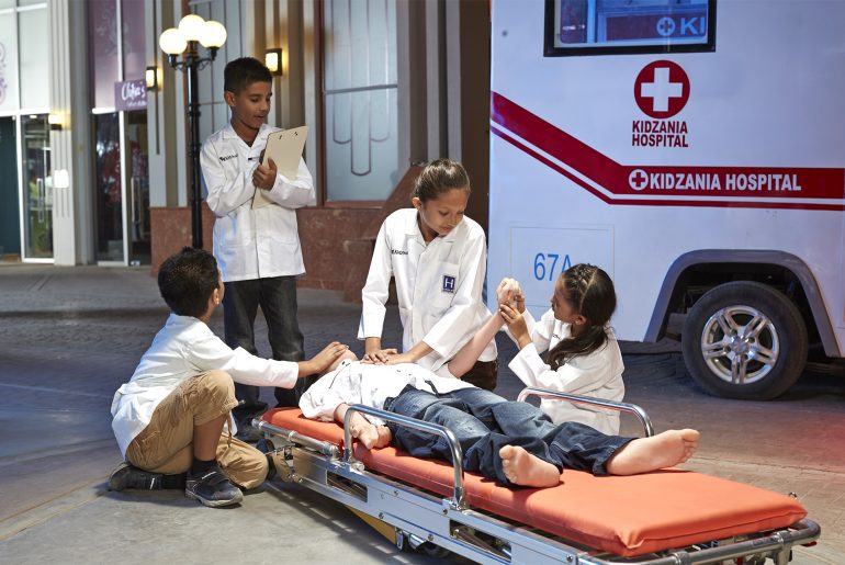 Kids enacting a hospital scene at Kidzania