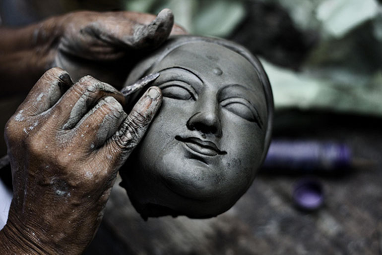 A Kumar crafting Durga from the silt of Ganges