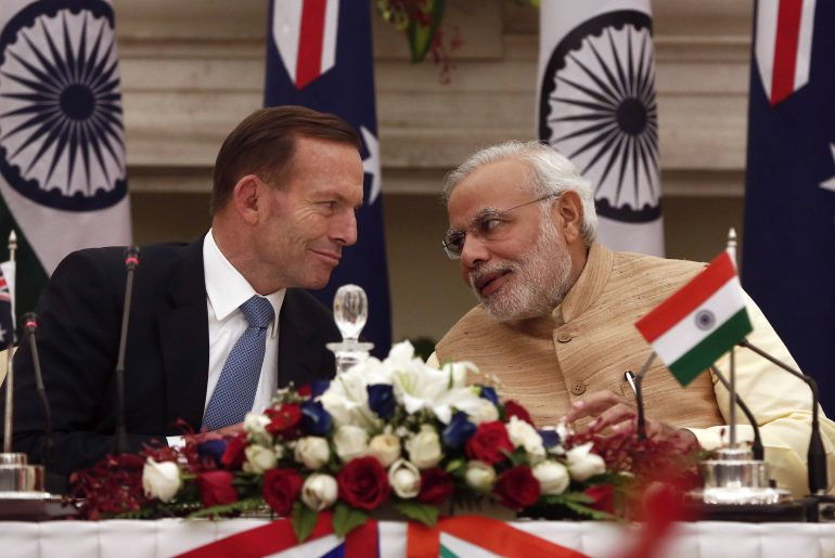 Australia's Prime Minister Tony Abbott (L) speaks with his Indian counterpart Narendra Modi during the signing of agreements ceremony in New Delhi September 5, 2014. Abbott sealed a civil nuclear deal to sell uranium to India on Friday and also offered to increase supplies of conventional fuel to help it overcome chronic shortages. REUTERS/Adnan Abidi (INDIA - Tags: POLITICS ENERGY BUSINESS)
