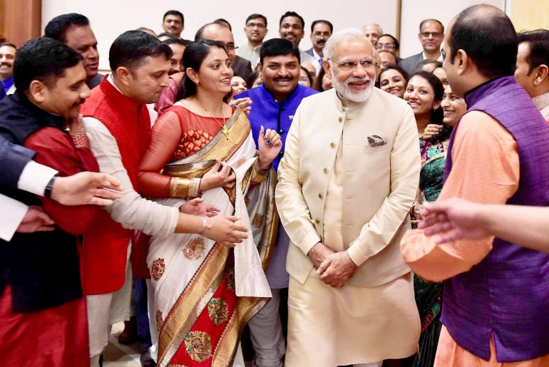 Doha:Prime Minister Narendra Modi interacts with the people of Indian Community in Doha, Qatar on Sunday. PTI (