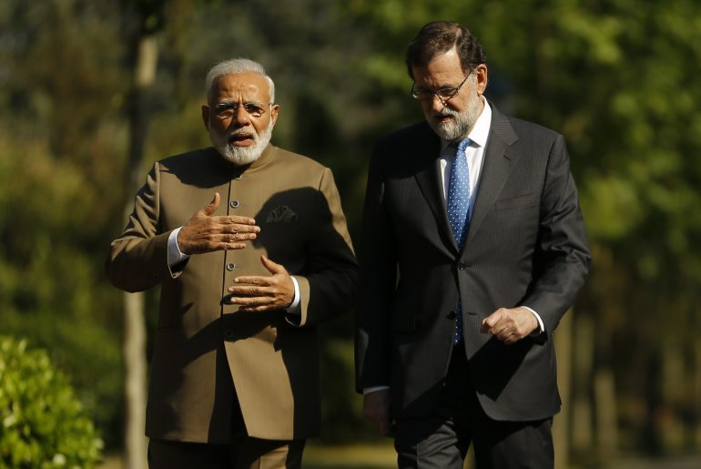 Indian Prime Minister Narendra Modi, left and Spanish Premier Mariano Rajoy walk in the gardens of the Moncloa Palace in Madrid, Spain, Wednesday May 31, 2017. Narendra Modi is on an official visit to Spain. (AP Photo/Francisco Seco)