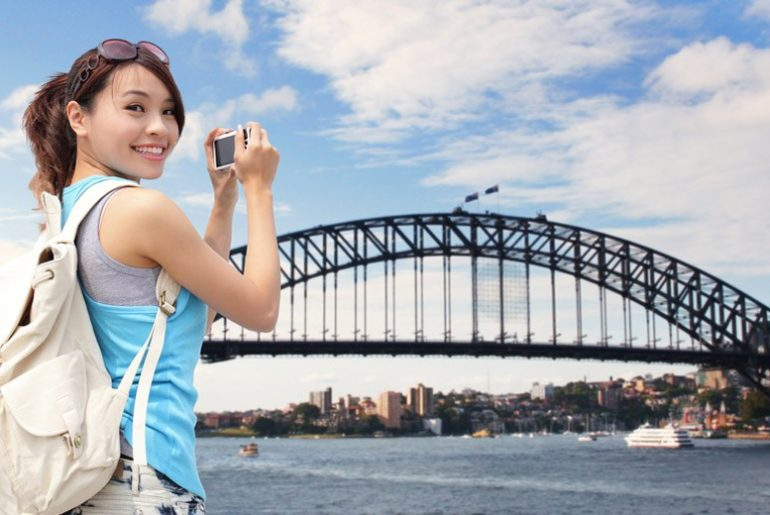 Chinese tourists take in the sites of the Sydney Harbour Bridge