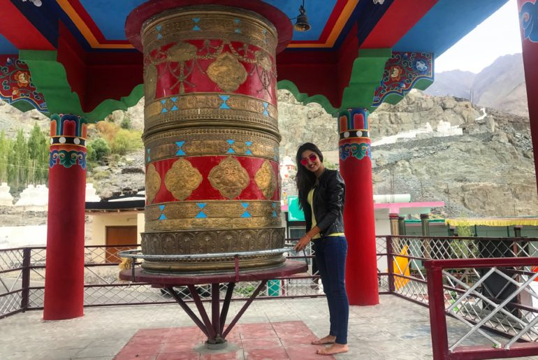 prayer wheel by the Buddha statute