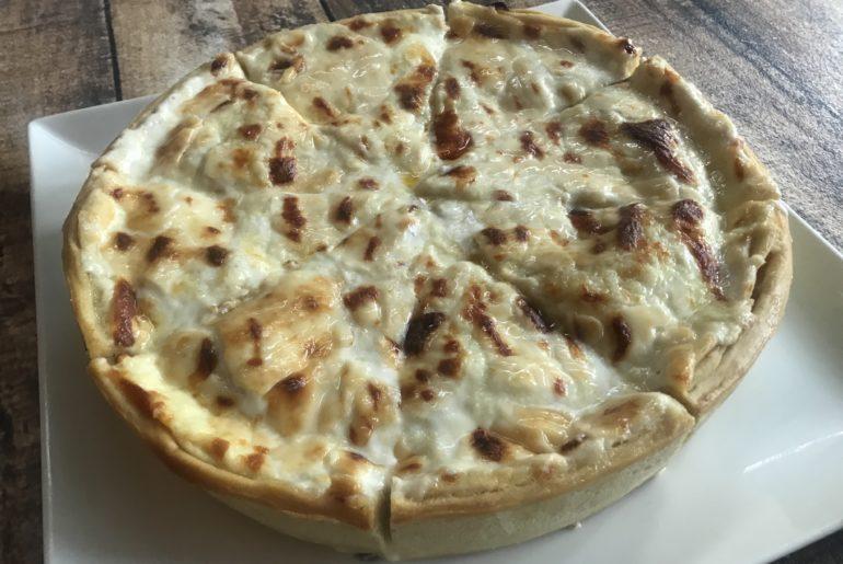 Deep dish cheese & artichoke pizza