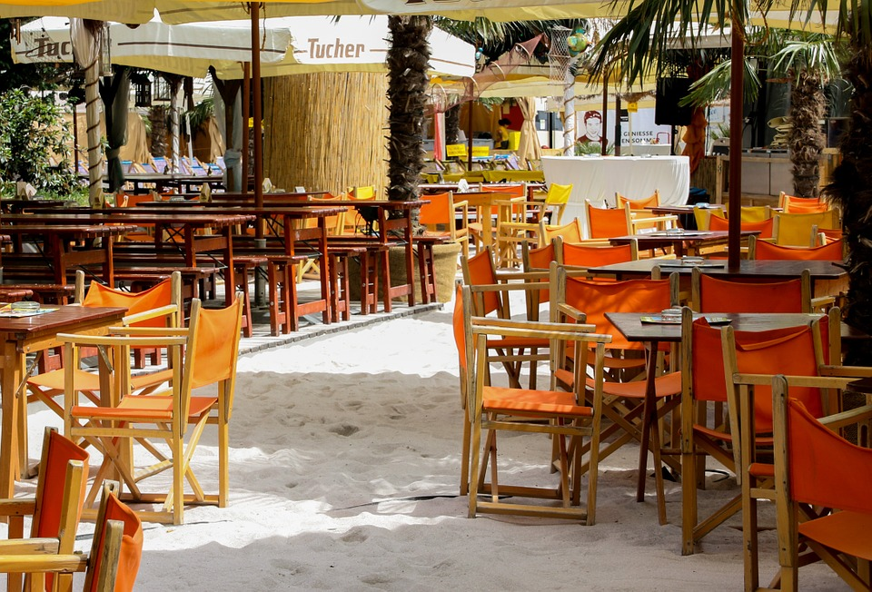 Have a lunch at a restaurant by the beach
