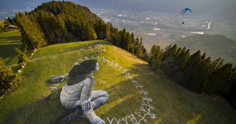 coronavirus themed Grass Graffiti Swiss Alps