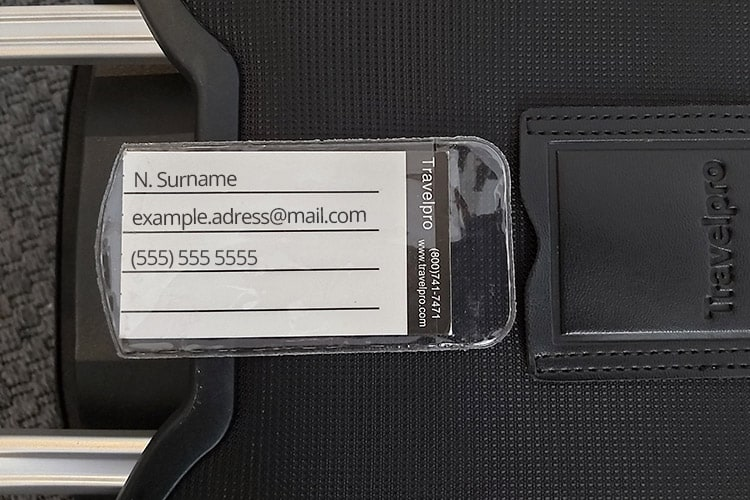 what to write on luggage tags